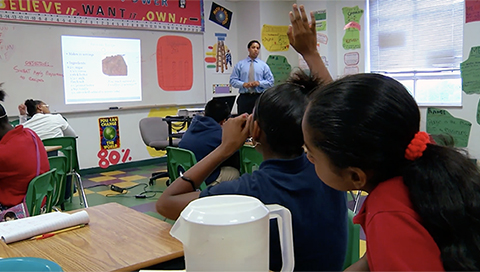 SchoolSmartKC girl raising her hand