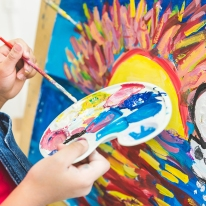 Child Painting - Success in Early Education Requires Innovation
