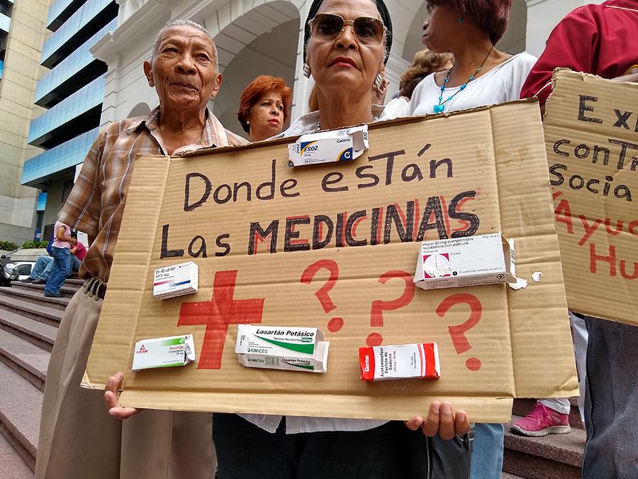 Venezuelan citizens hold signs asking: Donde están las medicinas? (Where are the medicines