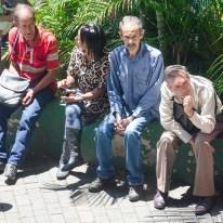 Venezuelans waiting to enter a bank