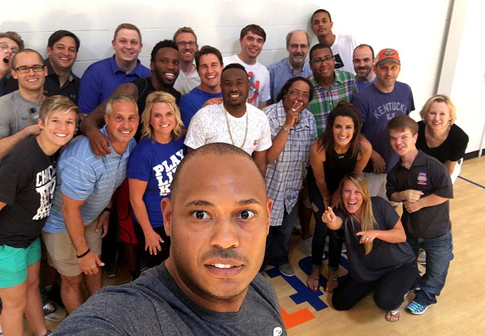 Davyeon Ross, founder of ShotTracker, takes a photo with his team